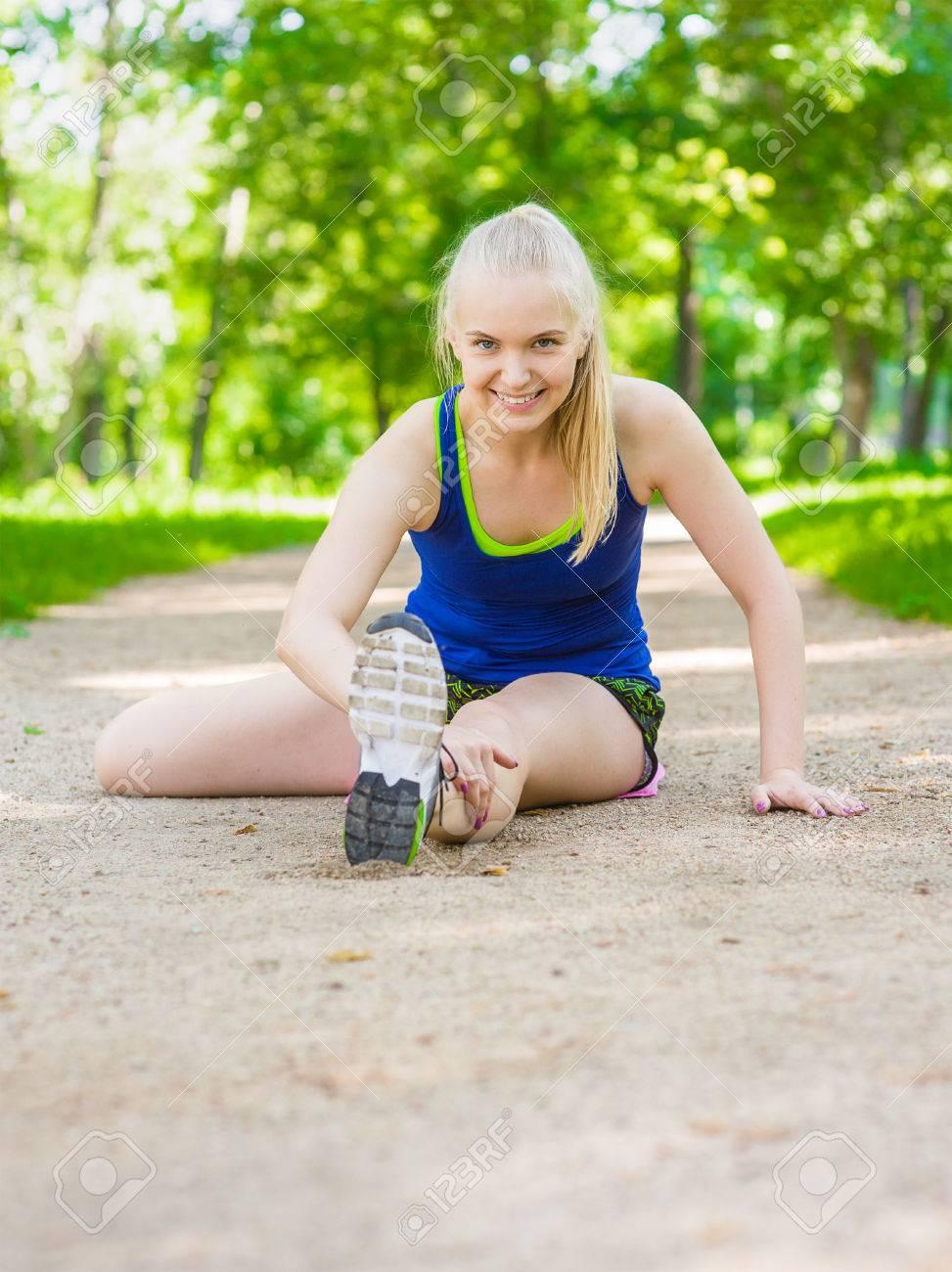 Happy Teen Girl Stretching Legs Before Run Stock Photo 60933899