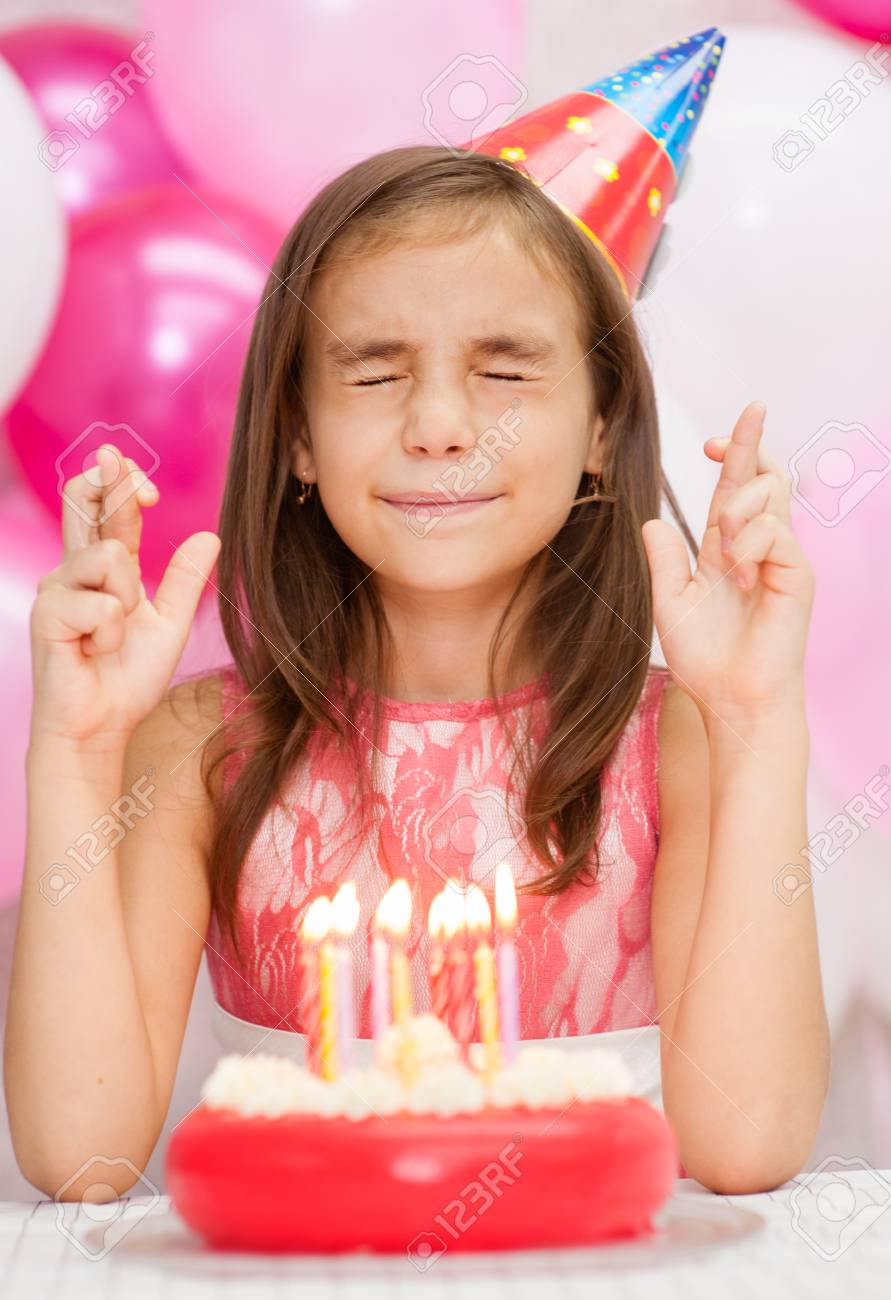 Sensational Girl The Birthday Hat With A Cake With Candles Makes A Wish With Funny Birthday Cards Online Elaedamsfinfo