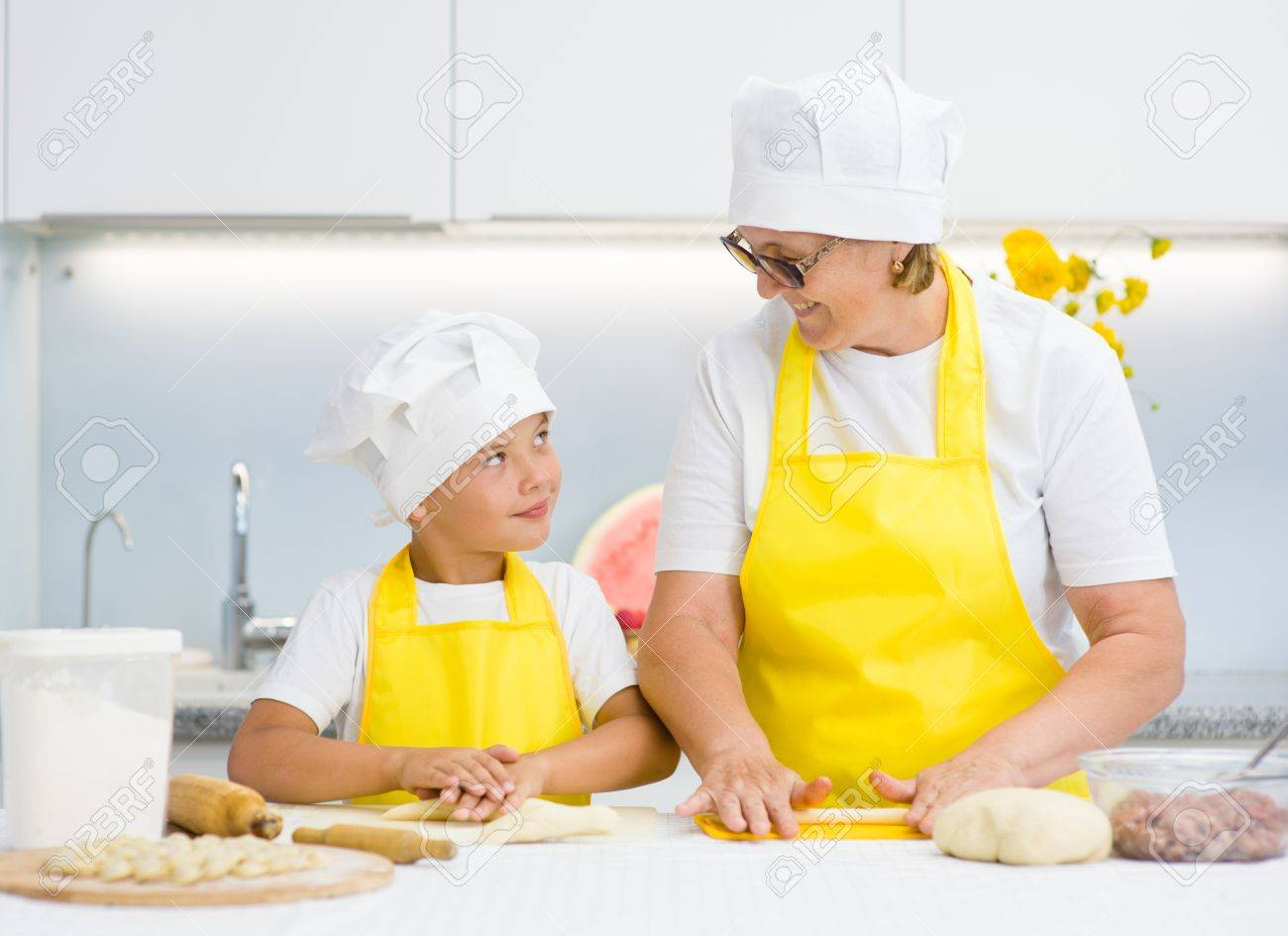 Grandma And Grandson Prepare Food At Home In The Kitchen. Stock ...