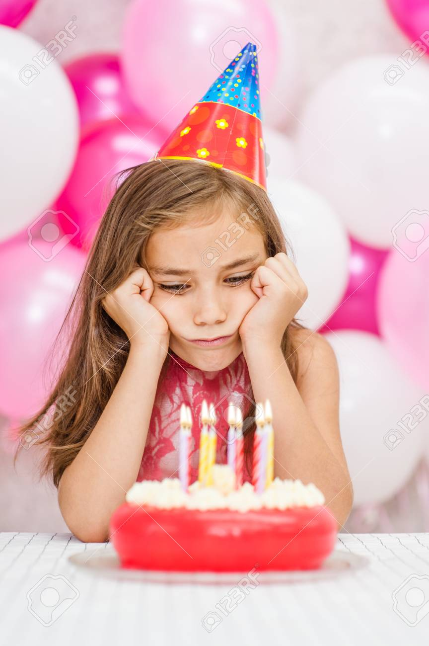 Terrific Sad Girl In Party Hat With Birthday Cake Stock Photo Picture And Funny Birthday Cards Online Aboleapandamsfinfo