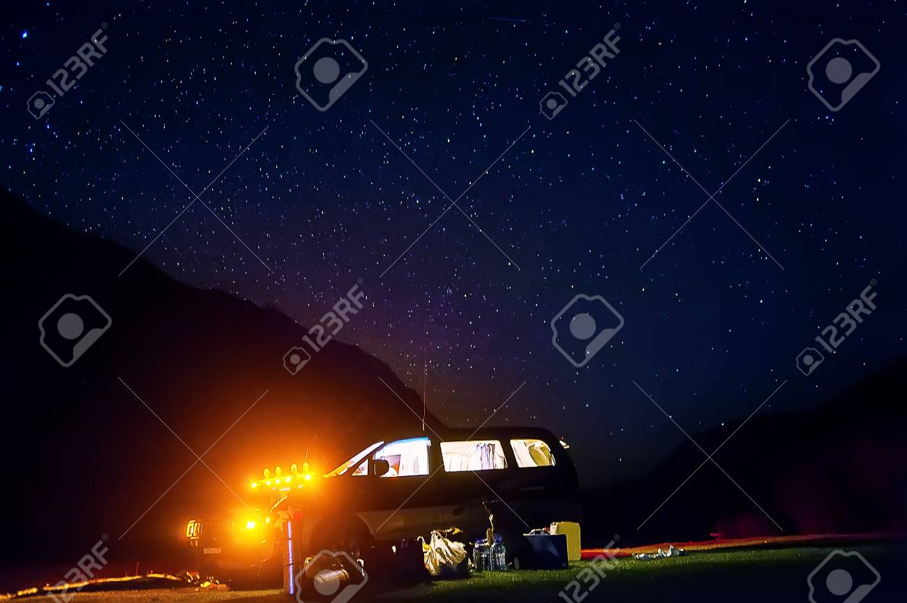 Camping With Tents And Car Under The Stars Night Romantic Couple Tourists Have