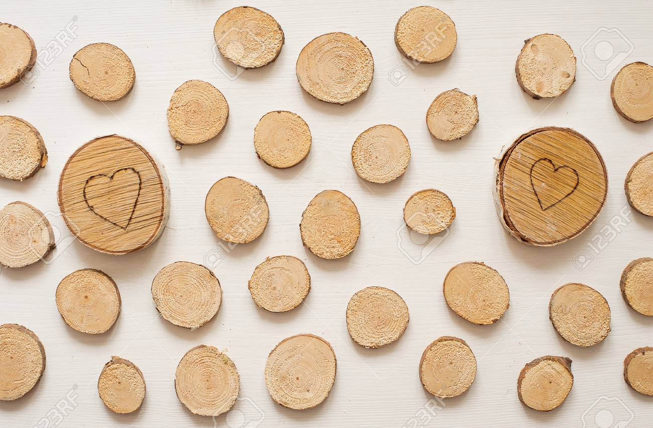 Small Pine Wooden Circles Pattern Wooden Saw Cut Isolated On