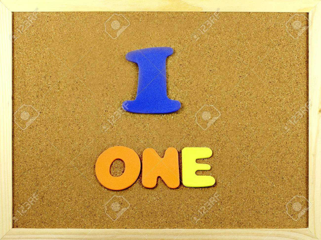 corkboard with the word and number one written with colorful letters stock photo 30938147