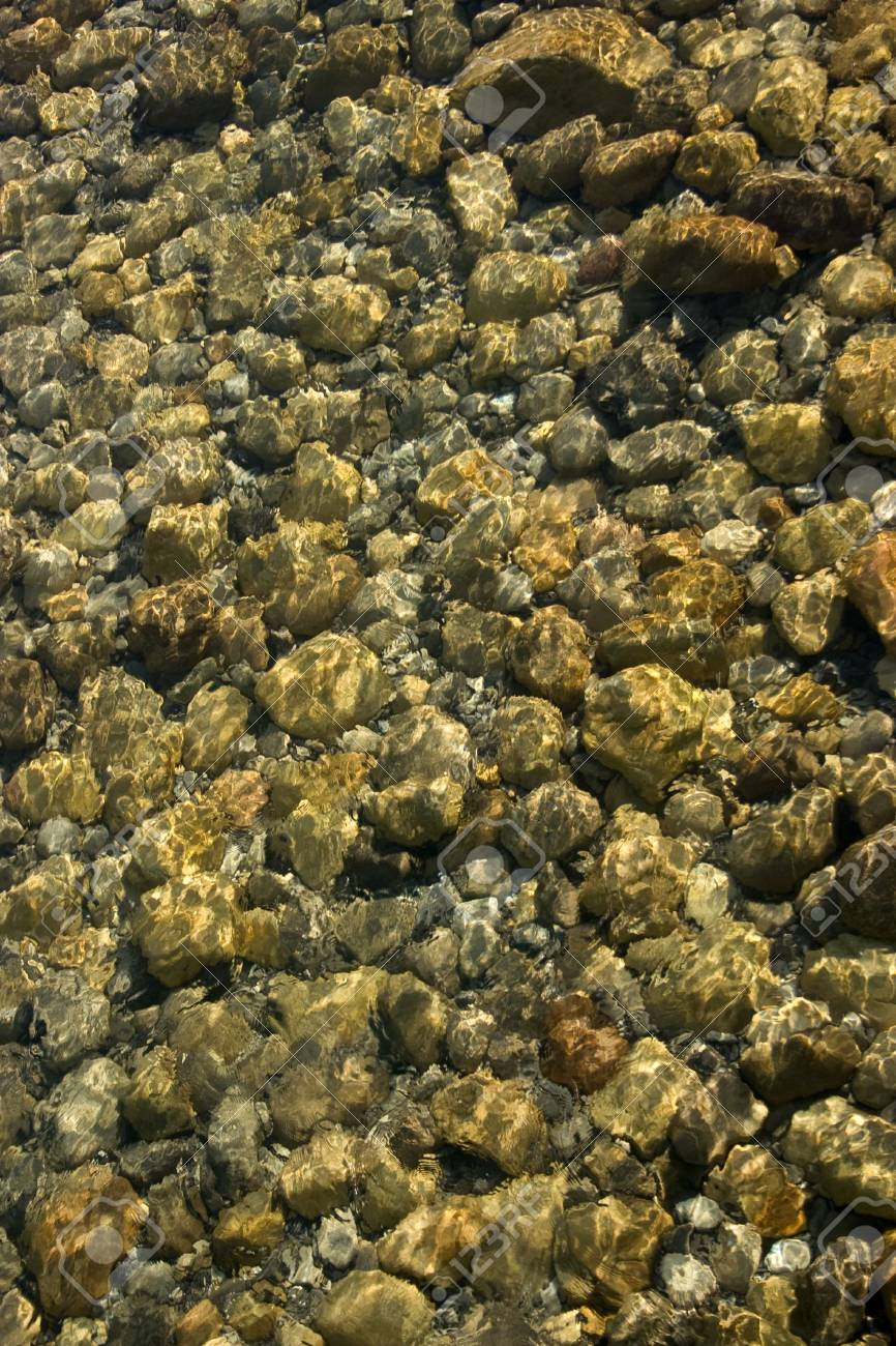 Rocks under water in a flowing stream. Stock Photo - 2410466