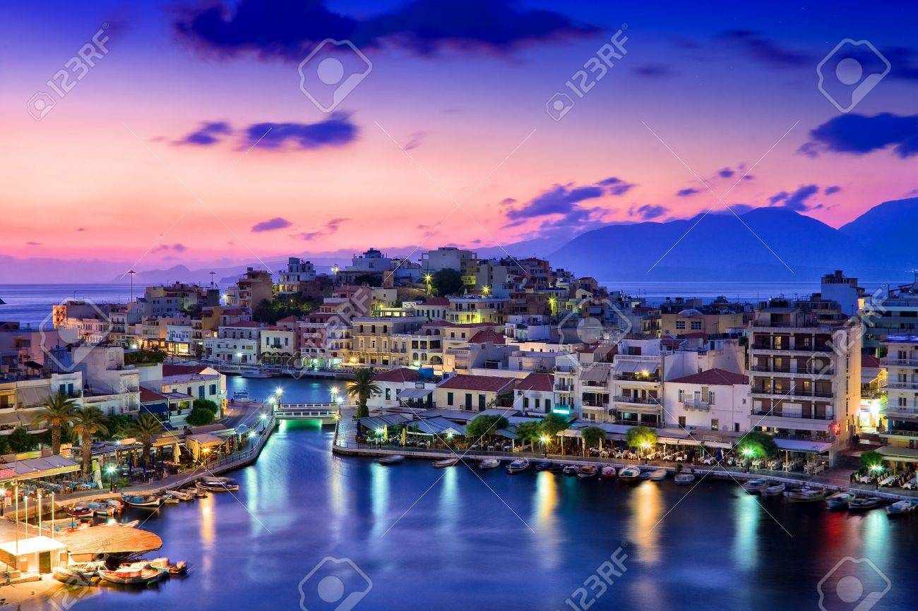 Agios Nikolaos. Agios Nikolaos is a picturesque town in the eastern part of the island Crete built on the northwest side of the peaceful bay of Mirabello. - 10019175