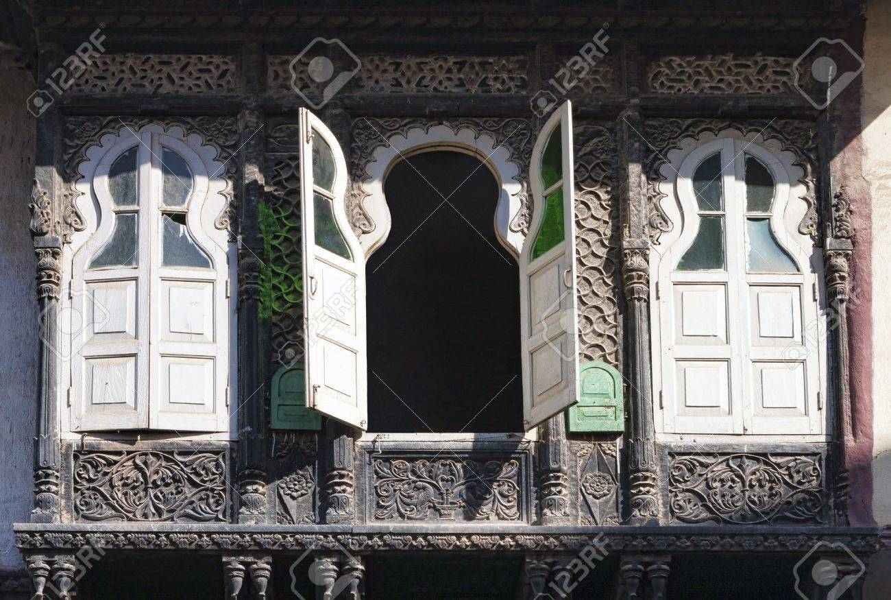 stock photo three old windows with shutters and decorative stone ornaments rajasthan india - Decorative Windows