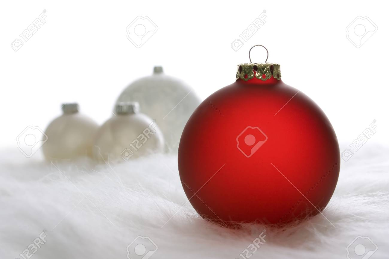 Arrangement of red and white Christmas baubles on white fur Stock Photo - 6071506