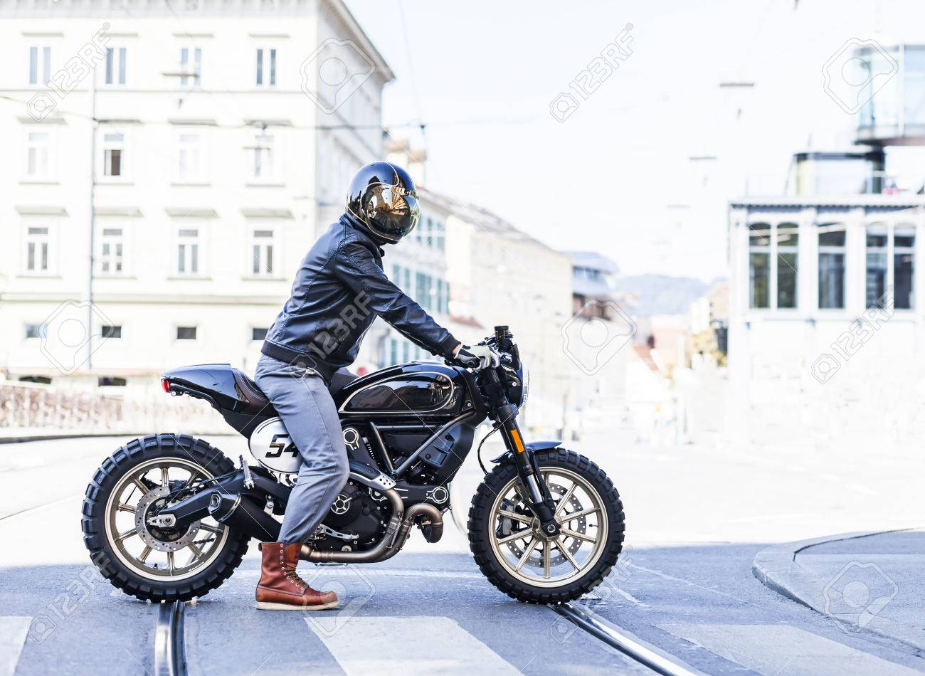 Motorcycle Rider On Custom Made Scrambler Style Cafe Racer In The City Stock Photo