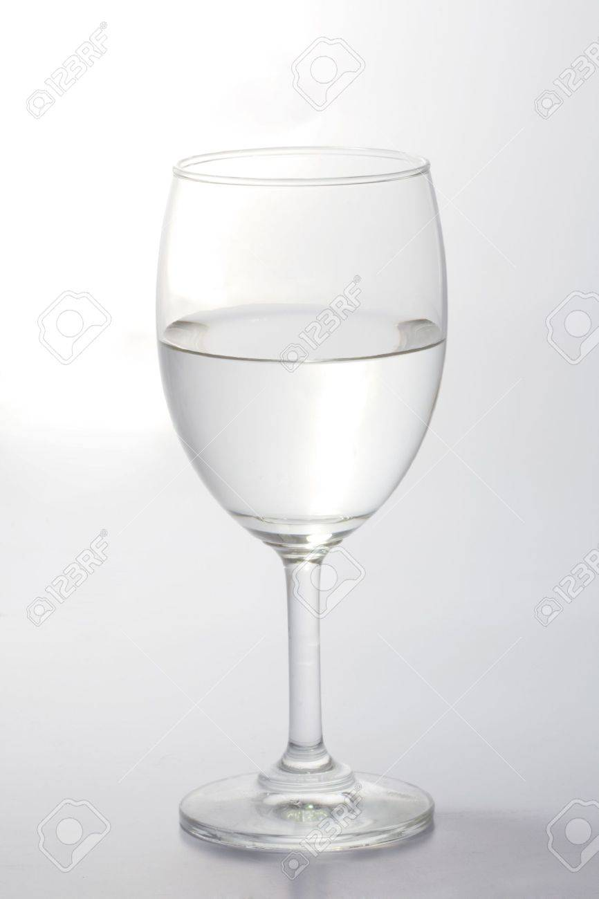 Glass of water half empty isolated on white background Stock Photo - 9144742