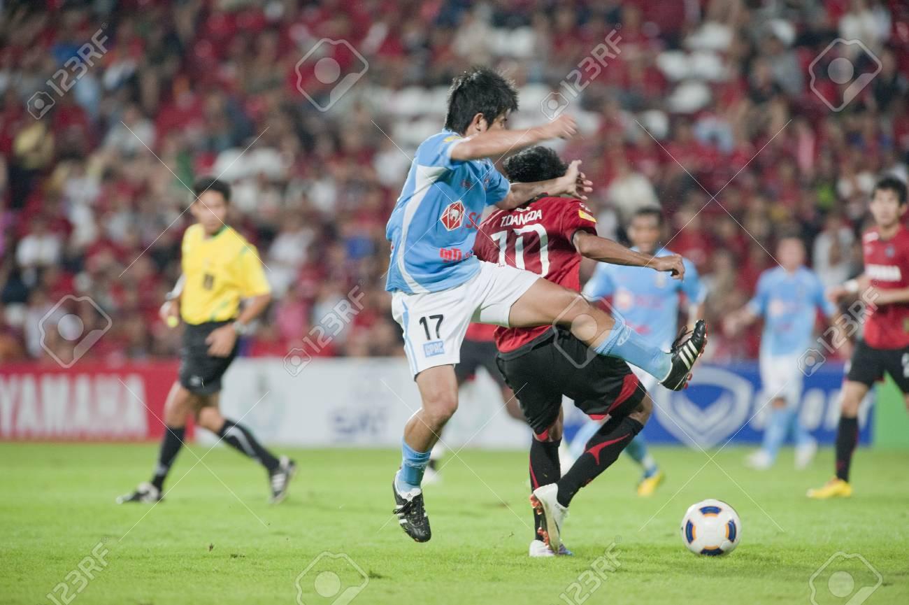 THAILAND- APR 17 : Thai Premier League (TPL) between Muang Thong utd (Red) vs SCG Samutsongkram Fc (Blue) on April 17, 2011 at  Yamaha Stadium Bangkok, Thailand Stock Photo - 9338513