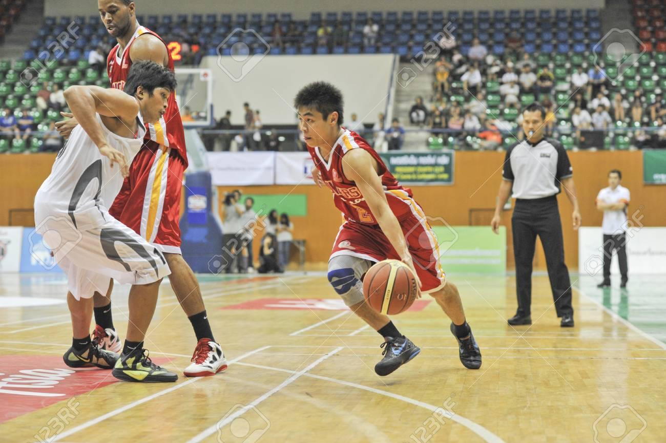 BANGKOK, THAILAND - FEB 5 : Asean Basketball League 2012 (ABL) between Slammers(W) vs Leader(R) at Thai-Japanese Stadium on February 5, 2012 in Bangkok, Thailand  Stock Photo - 12368430