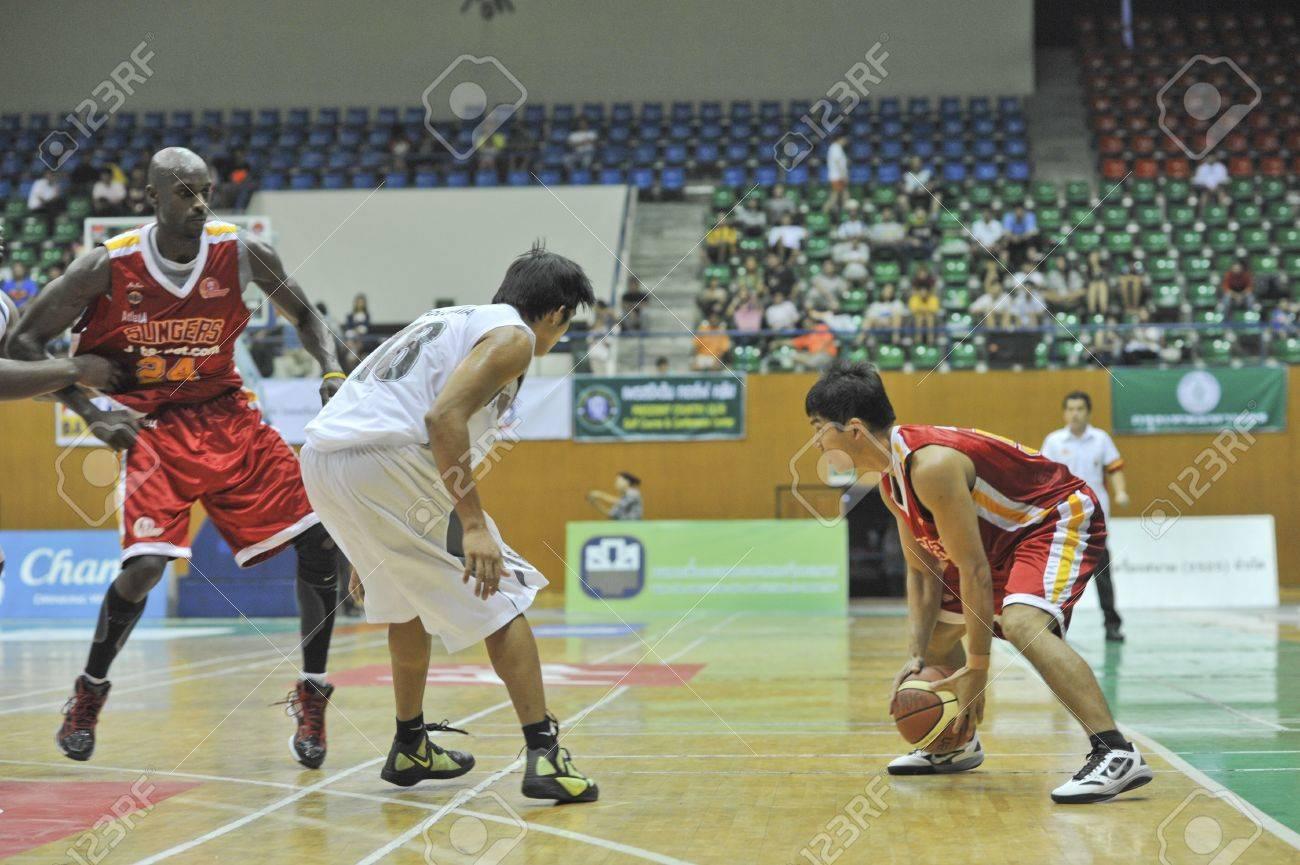 BANGKOK, THAILAND - FEB 5 : Asean Basketball League 2012 (ABL) between Slammers(W) vs Leader(R) at Thai-Japanese Stadium on February 5, 2012 in Bangkok, Thailand  Stock Photo - 12368389