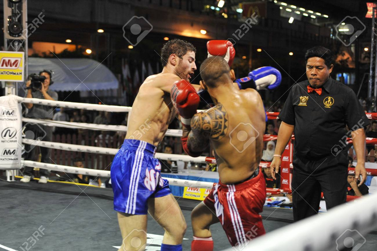 BANGKOK, THAILAND- MARCH 22 : Unidentified athletes compete in World Amateur Muaythai Champioships 2012. on March 22, 2012 at National Stadium, Bangkok, Thailand  Stock Photo - 12925829