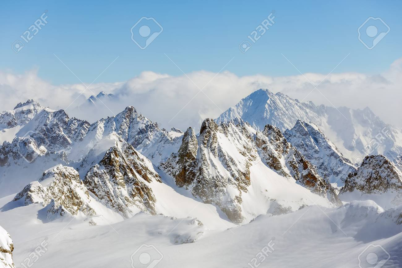 Wintertime view from Mt. Titlis in Switzerland. The Titlis is a mountain, located on the border between the Swiss cantons of Obwalden and Bern, it is mostly accessed from the town of Engelberg on its northern side. - 100013811