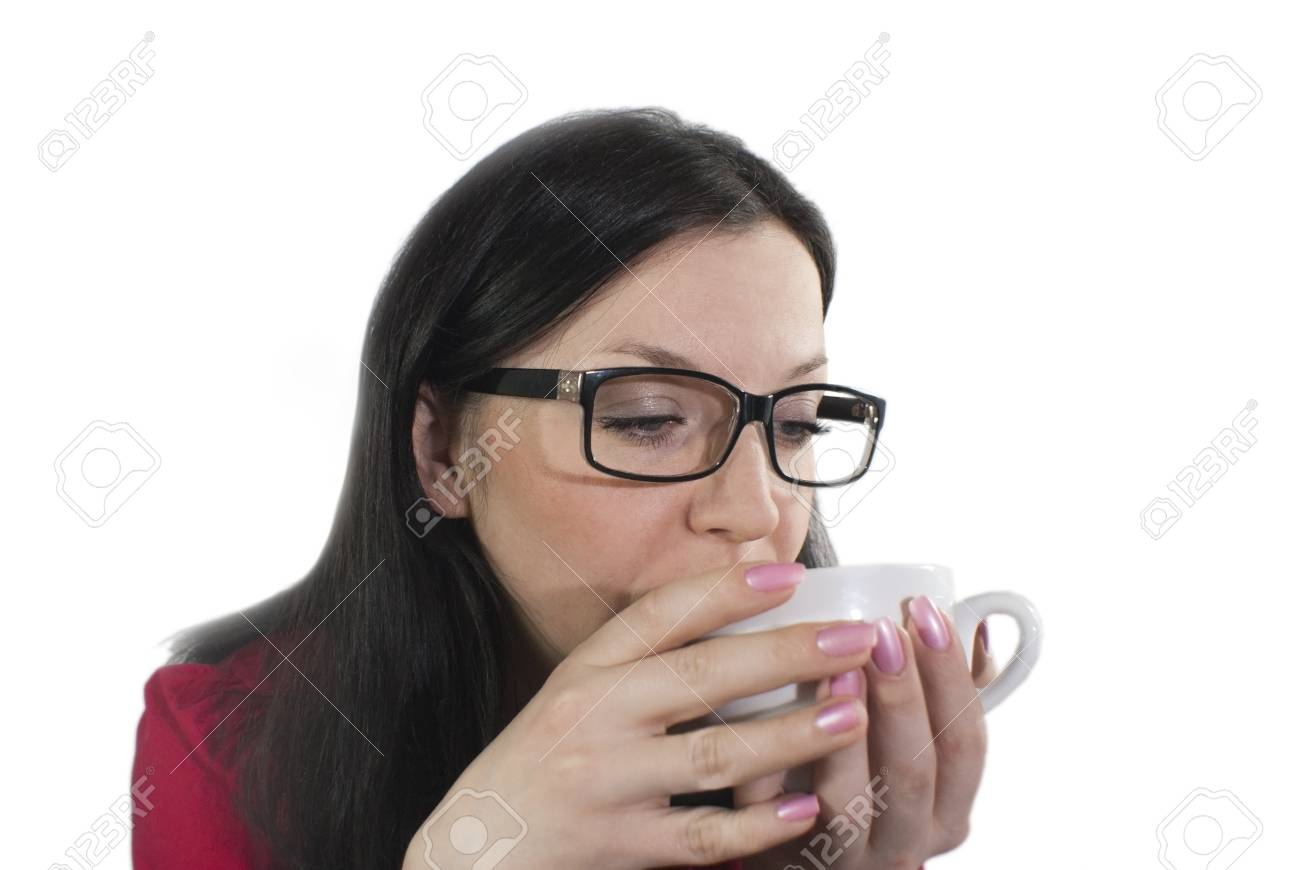 brunette girl with glasses trying to flavored coffee Stock Photo - 11890495