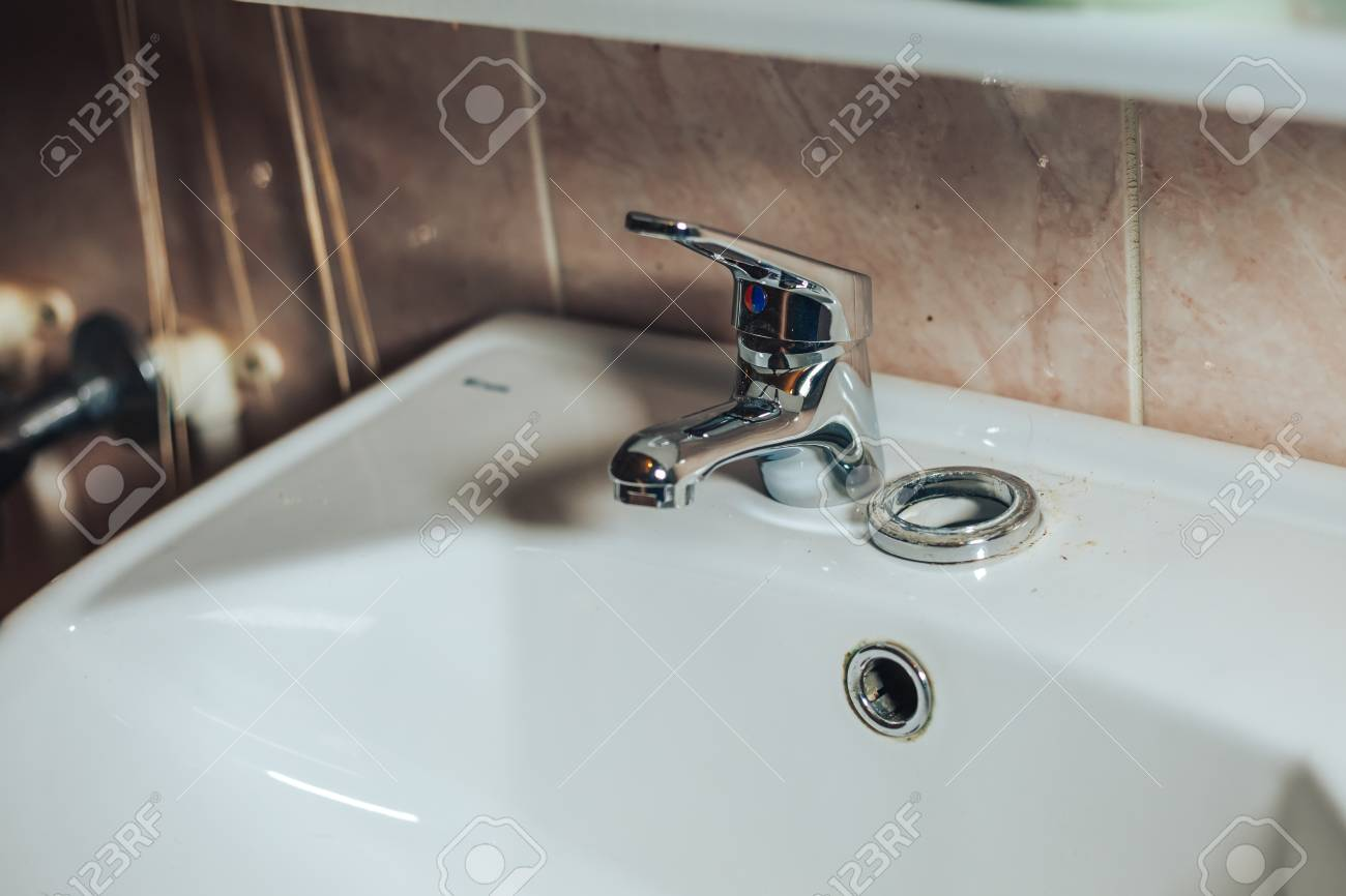 Man Repair And Fixing Leaky Old Faucet In Bathroom. The Man Unpacked ...