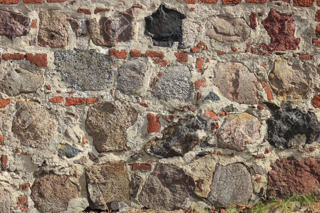 decorative wall made of bricks and natural stones Stock Photo - 13275747