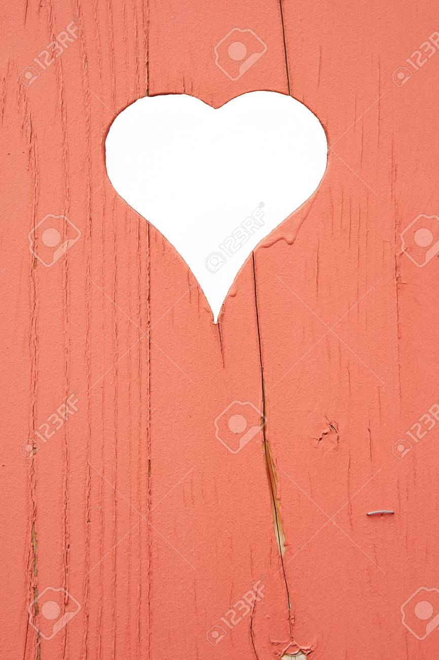 Heart shape cut out of a wall of wooden planks Stock Photo - 14348573