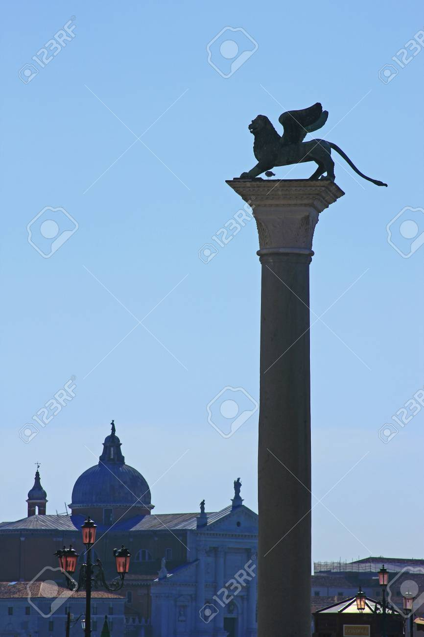 Silhouette of the lion of St  Mark on St  Mark s Place in Venice Stock Photo - 16729621