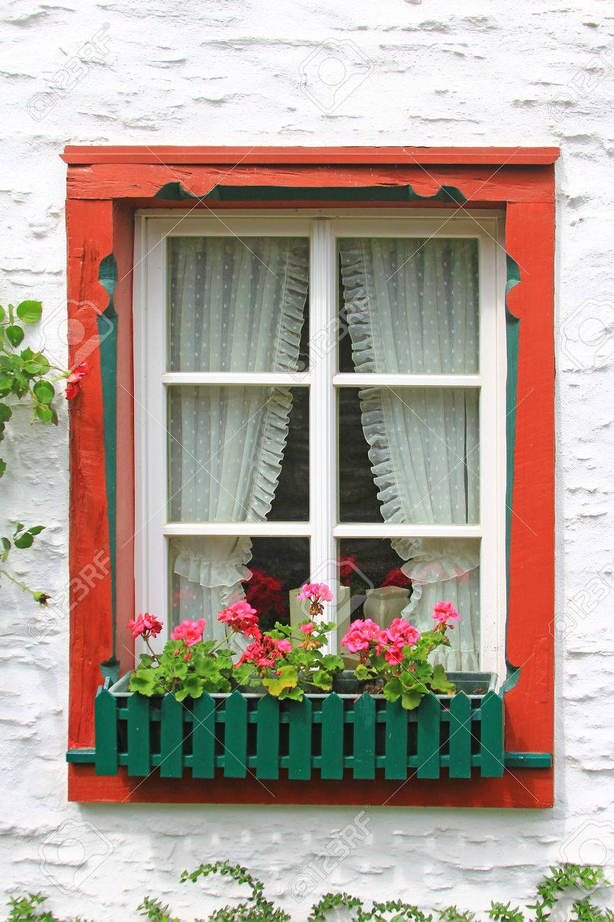 Decorative wooden window with floral decorations in Monreal, Eifel, Rhineland-Palatinate, Germany Stock Photo - 26745024