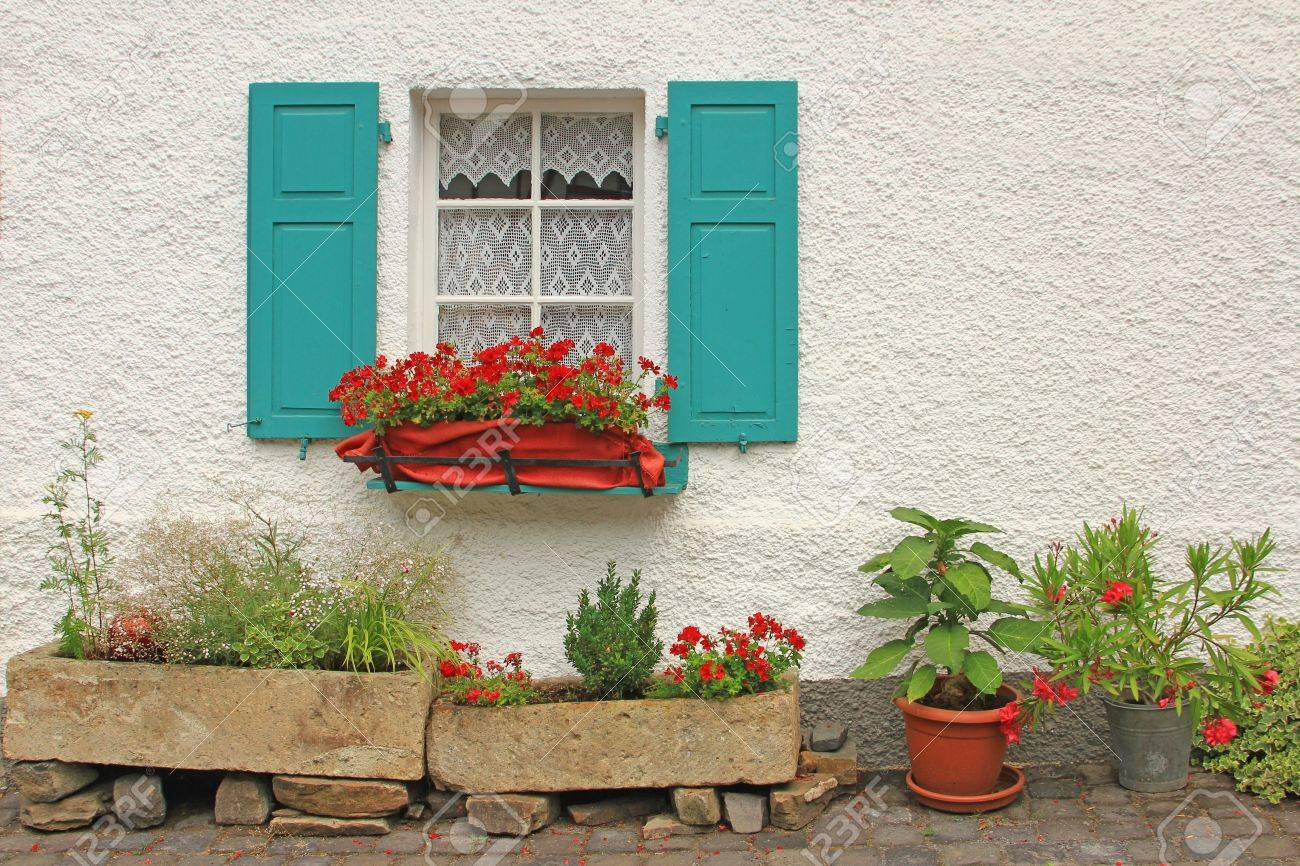 Decorative wooden window with floral decorations in Monreal, Eifel, Rhineland-Palatinate, Germany Stock Photo - 26745030