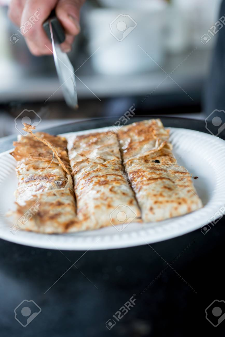 Cooked crepe in paper plate sliced into three equal sizes using a knife Stock Photo - & Cooked Crepe In Paper Plate Sliced Into Three Equal Sizes Using ...