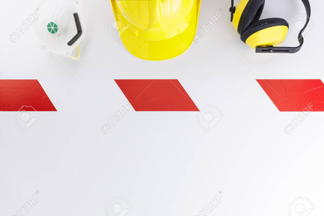 Barrier tape strip, face mask, hard hat, and earmuffs on white background  with