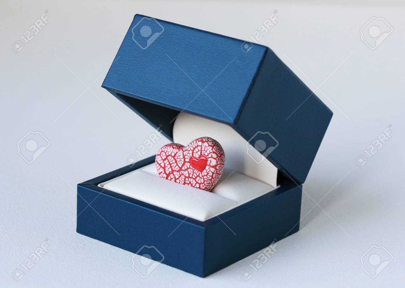 An Image Of A Bright Red And White Ceramic Heart Inside A Blue