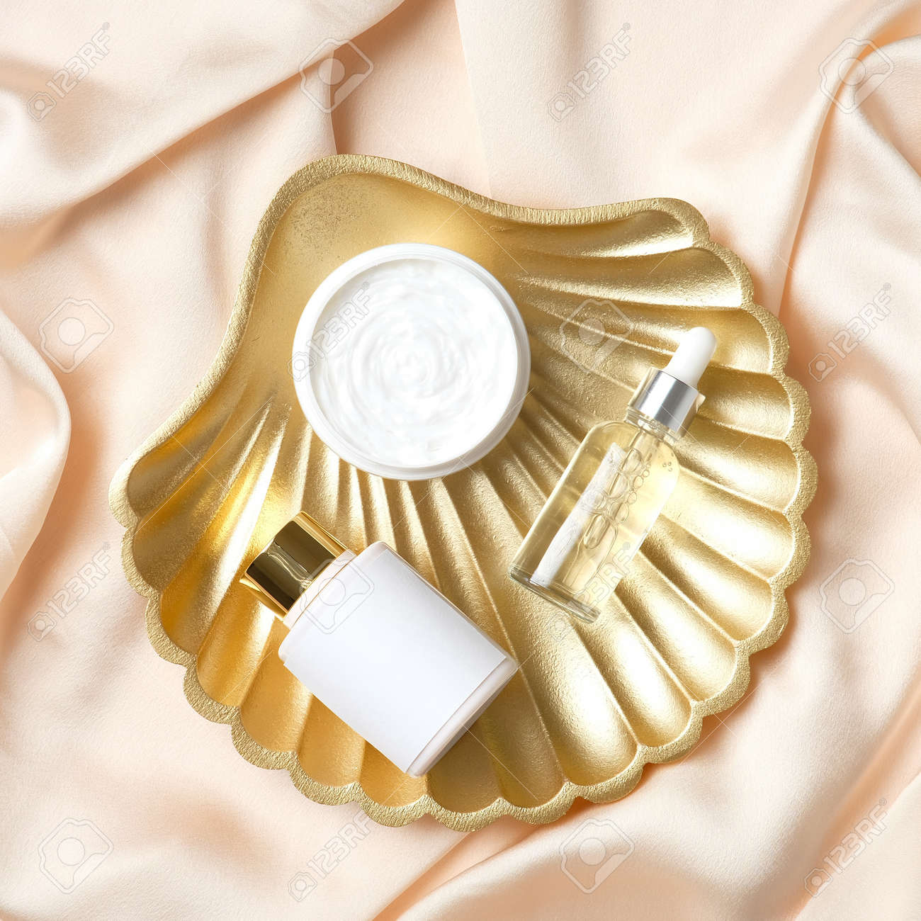 Golden pearl shell decoration with set of cosmetics products. Flat lay, top view. - 169340660