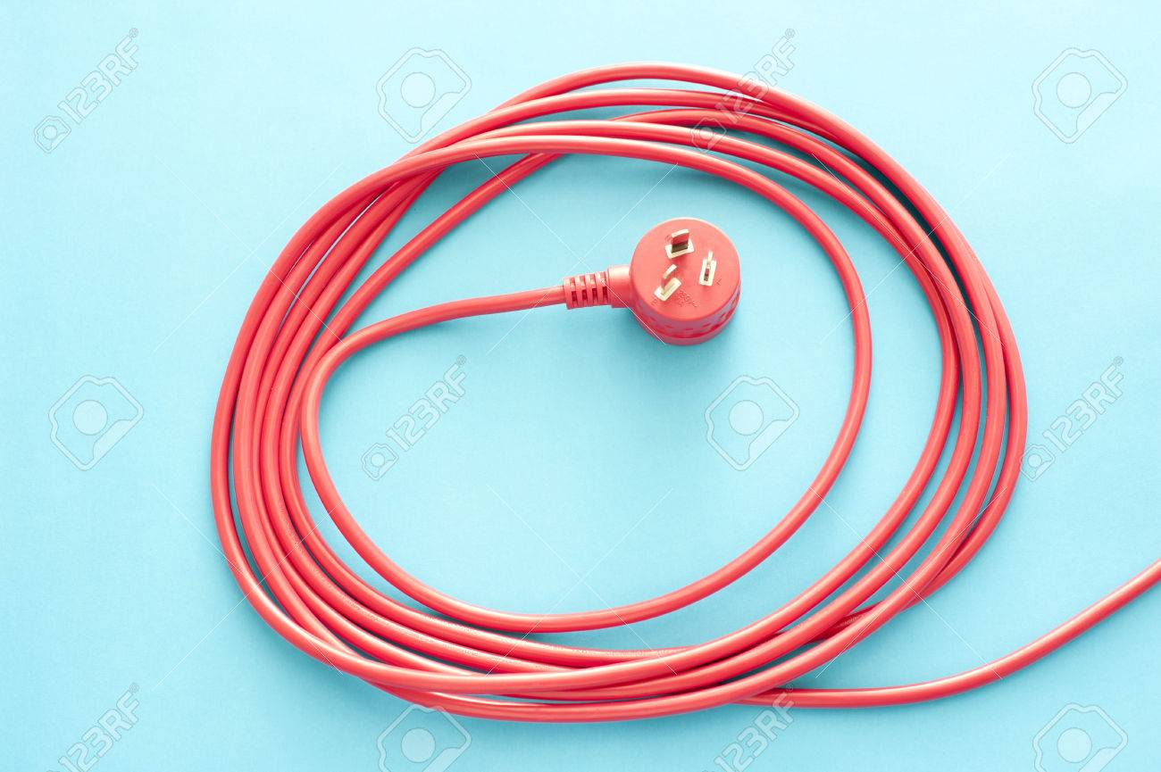 Coiled Red Electrical Cable Or Lead With A Three Prong Integrated ...