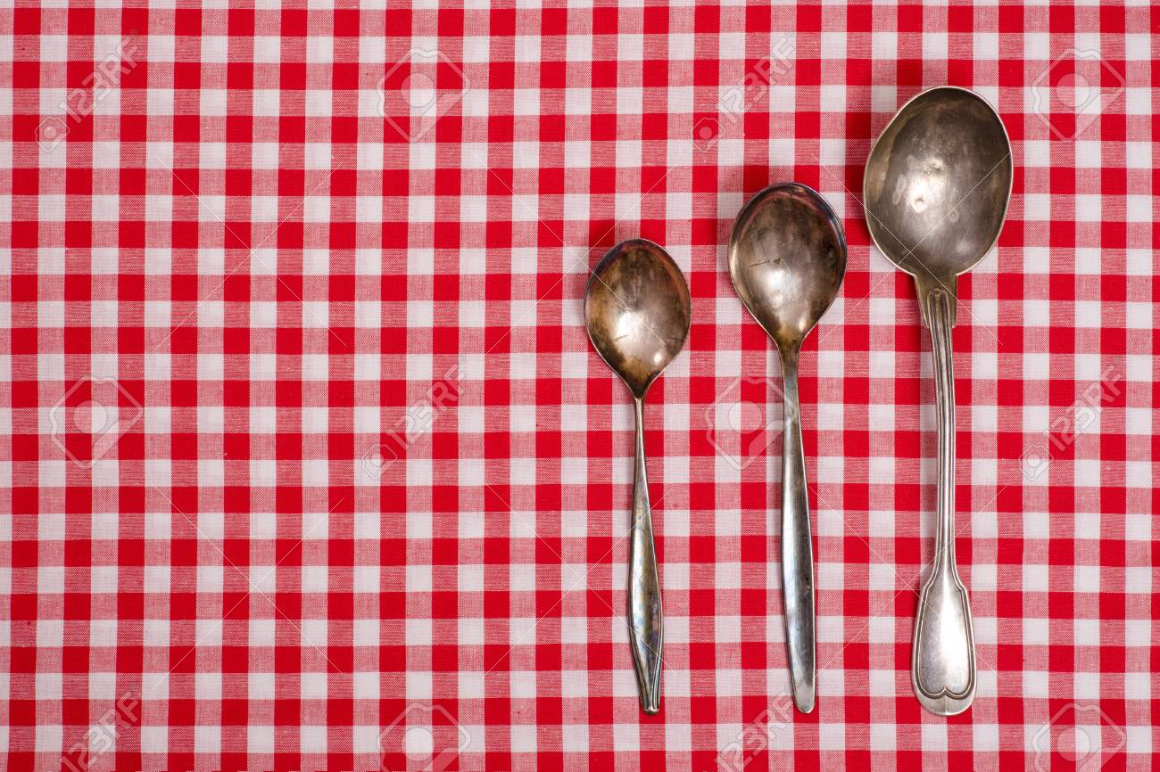 Red And White Checked Table Cloth With Old Silver Spoons Stock Photo    20688637
