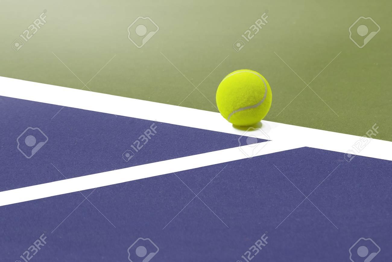 Tennis Ball Placed On White Border Line Inside Of Tenis Court Stock