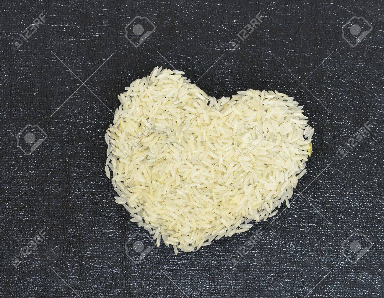Concept, Jasmine rice picture the heart on black background Stock Photo - 11039687