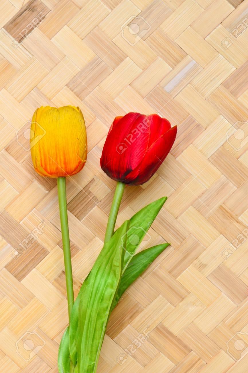Tulips on bamboo background Stock Photo - 11448520