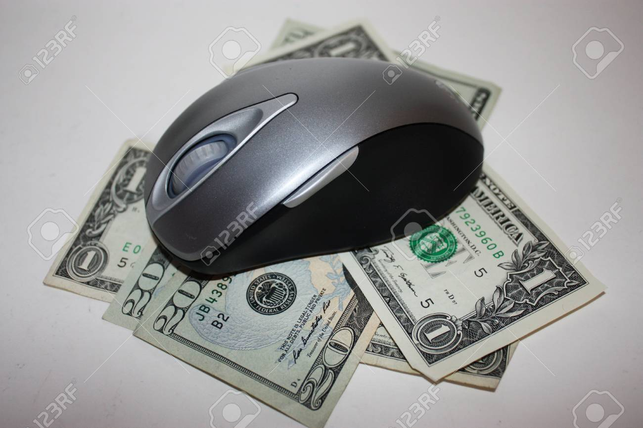 Money with a computer mouse on top to signify online savings Stock Photo - 11429982