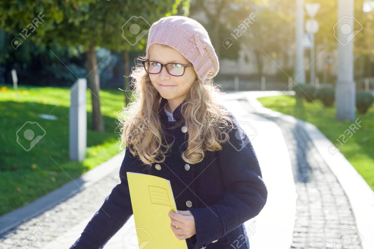 05c5b9ef0c Stock Photo - Street portrait of a cute girl in glasses