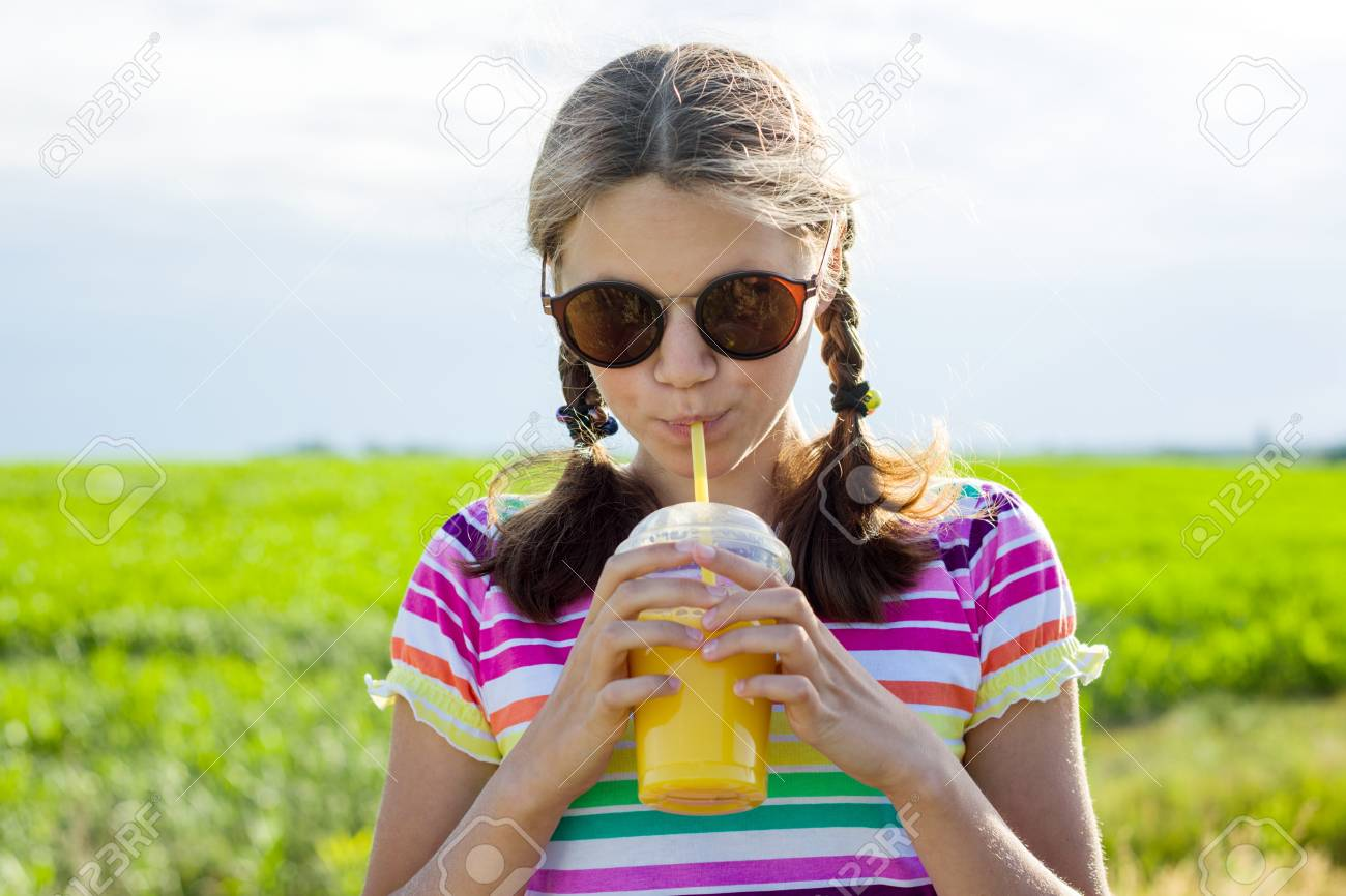 Happy Teen Girl Drinking Orange Juice At Hot Summer Day Outdoor Stock Photo 97403899