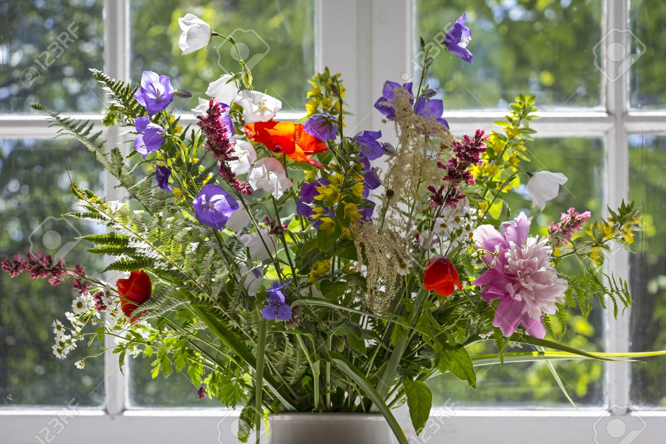 A Beautiful Bouquet Consisting Of Meadows And Garden Flowers Stock
