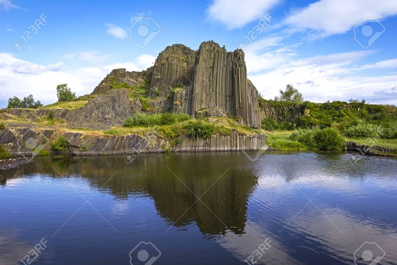 Interesting polygonal structures of basalt columns, also named Herrnhausfelsen, natural monument Panska skala near NovyBor (Czech Republic). Basalt is a extrusive volcanic rock formed from the rapid cooling of basaltic lava. - 82087441