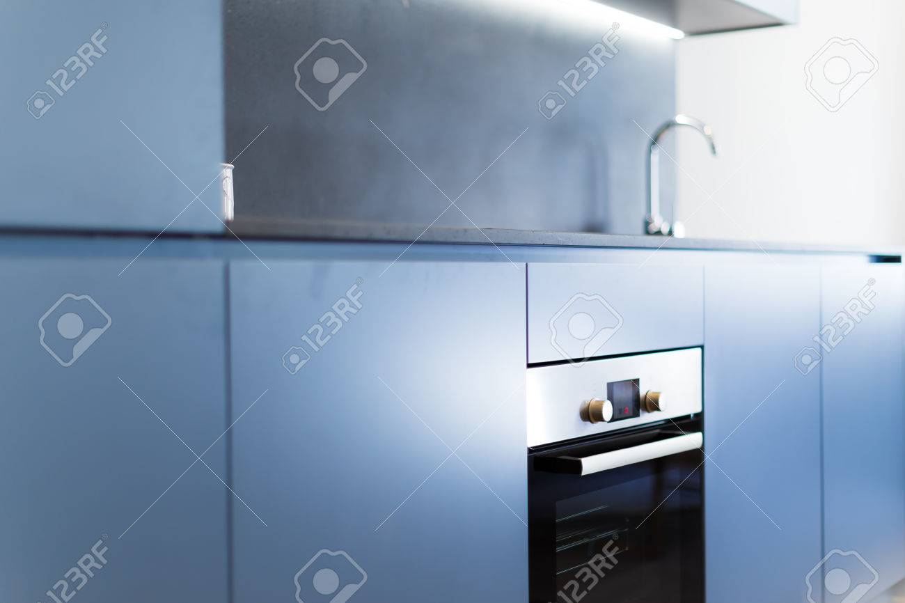 Blue Modern Kitchen Cabinets With Fit Oven And Tap In The Background ...