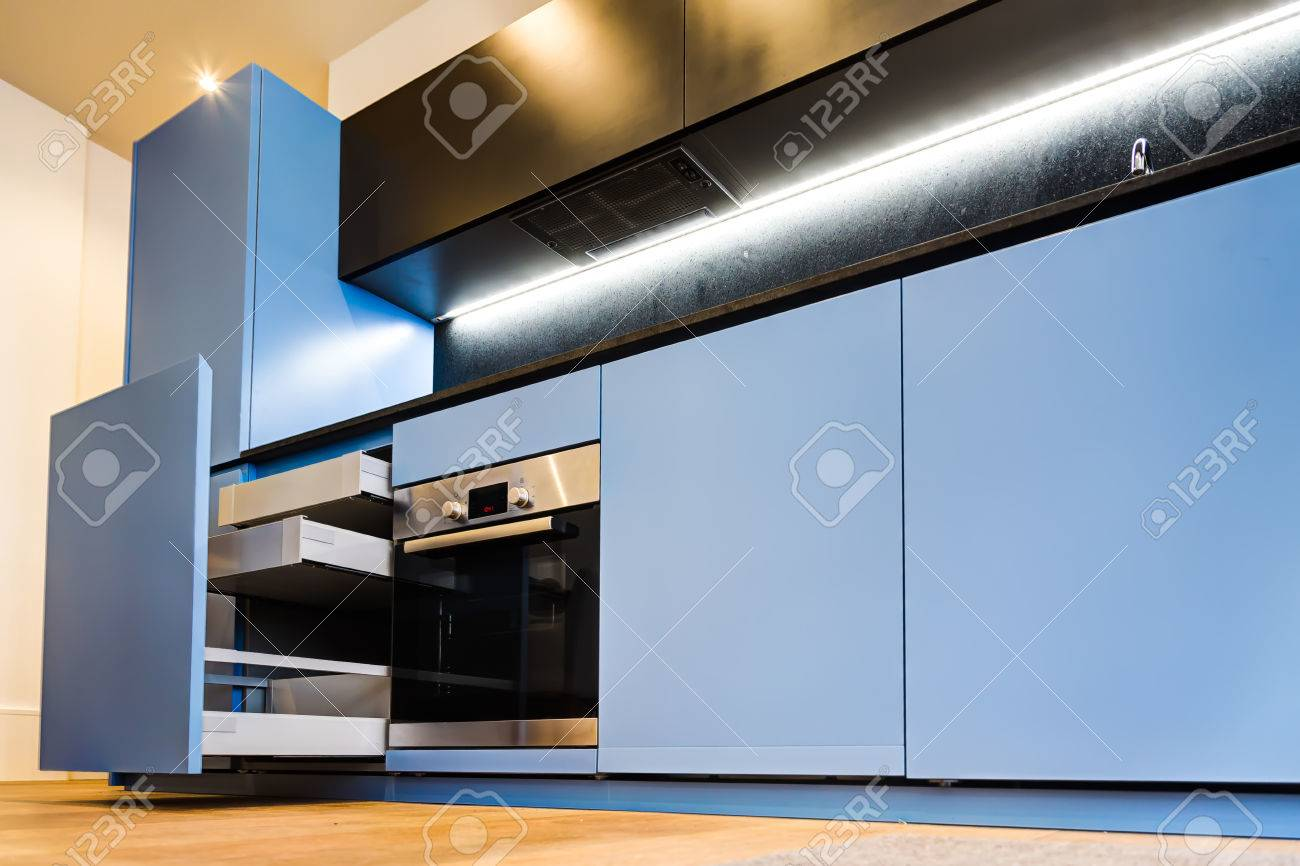 Modern And Stylish Blue Kitchen Cabinets And Open Drawers Stock ...
