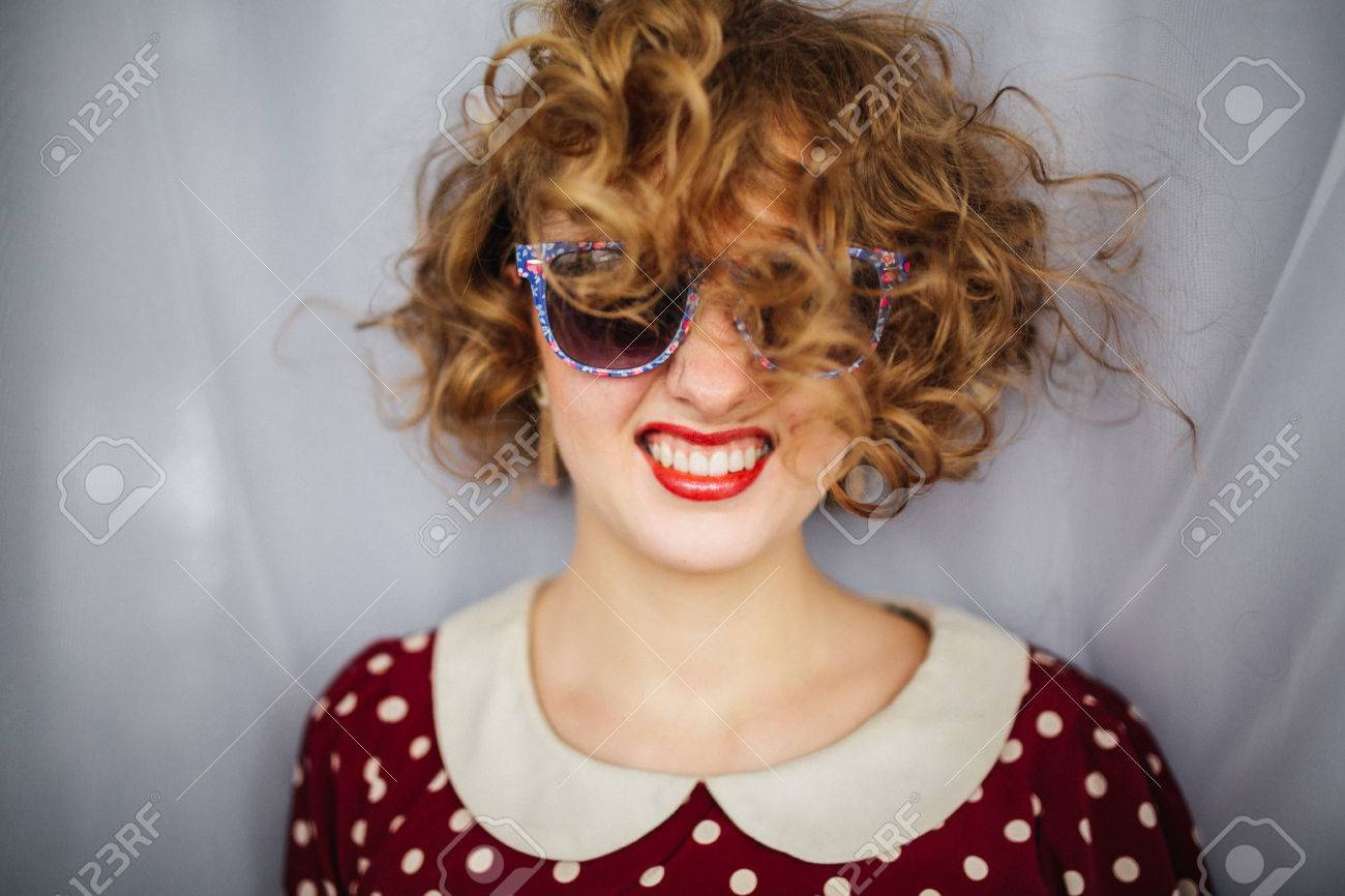 Beautiful Girl With Curly Short Hair Red Lips In Retro Glasses Stock