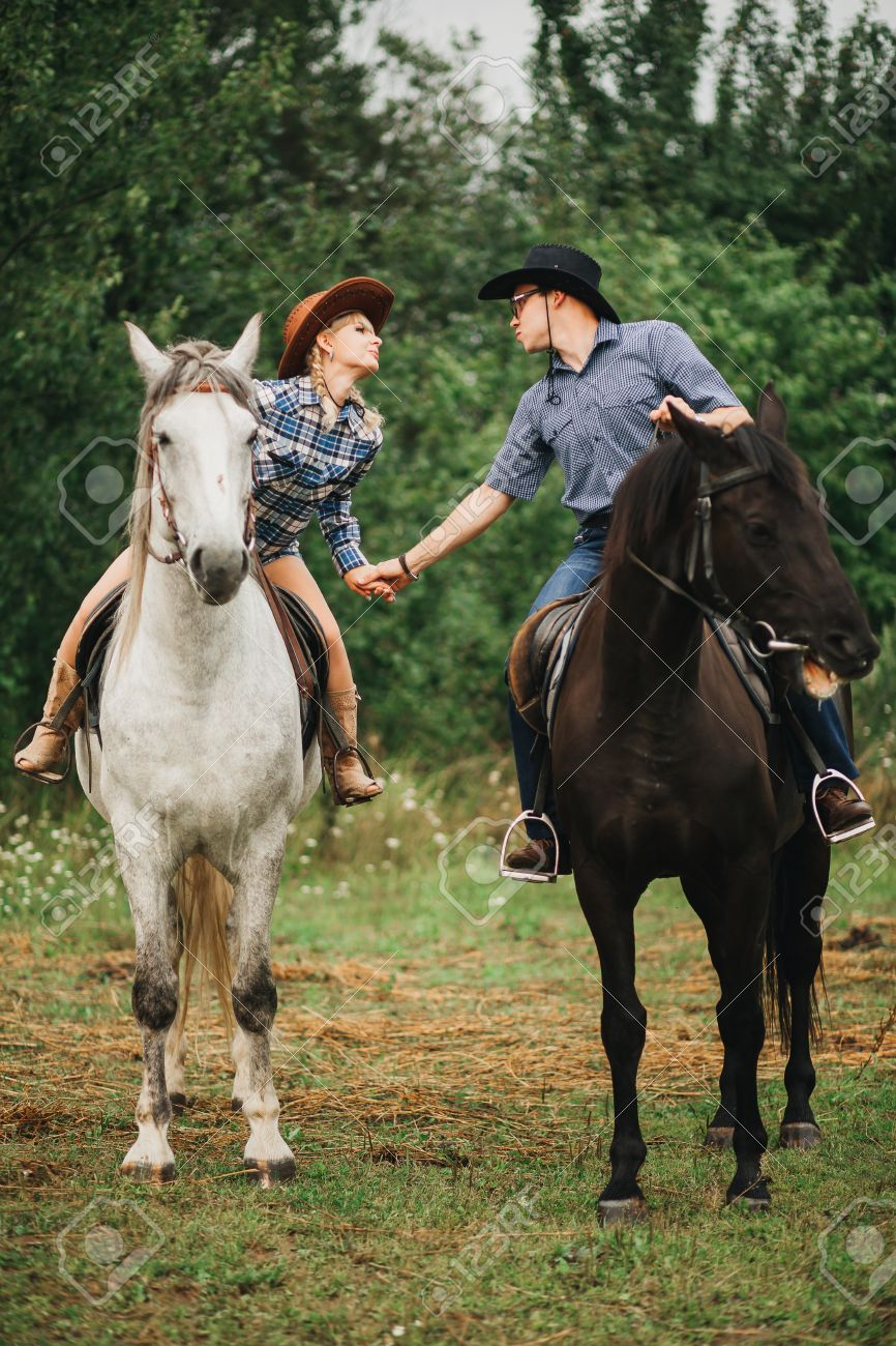 a63b6e225 loving couple man and woman in a cowboy hat riding a horse