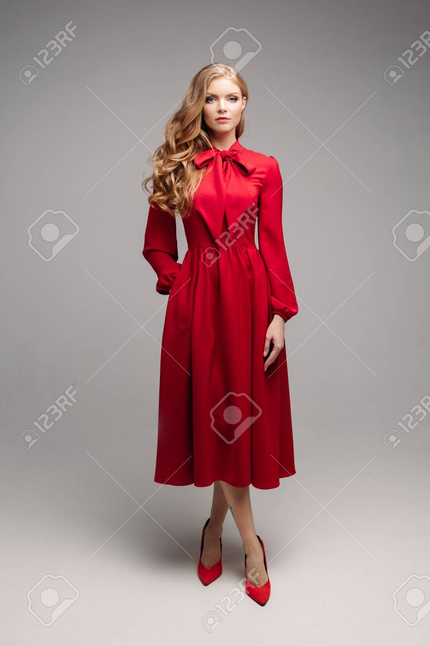 af74a1b49f4 Stunning slim model in bright red dress and black heels. Stock Photo -  113824756