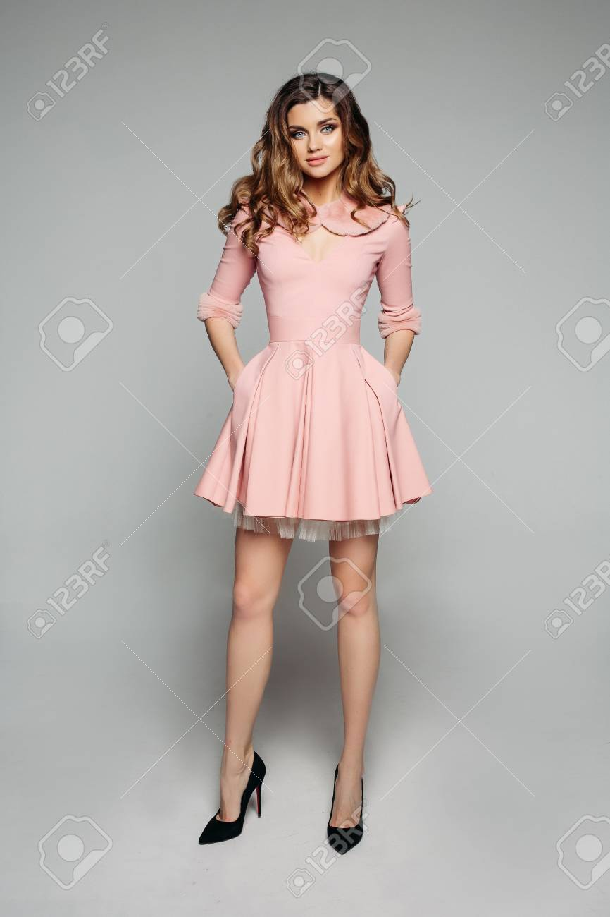 340117746562 Elegant model in pink dress and black heels. Stock Photo - 114242500