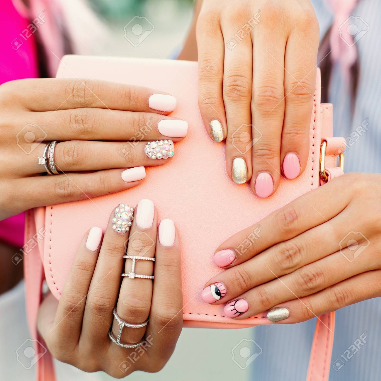 Close up of bag with girls hands with manicure over it. - 120001326