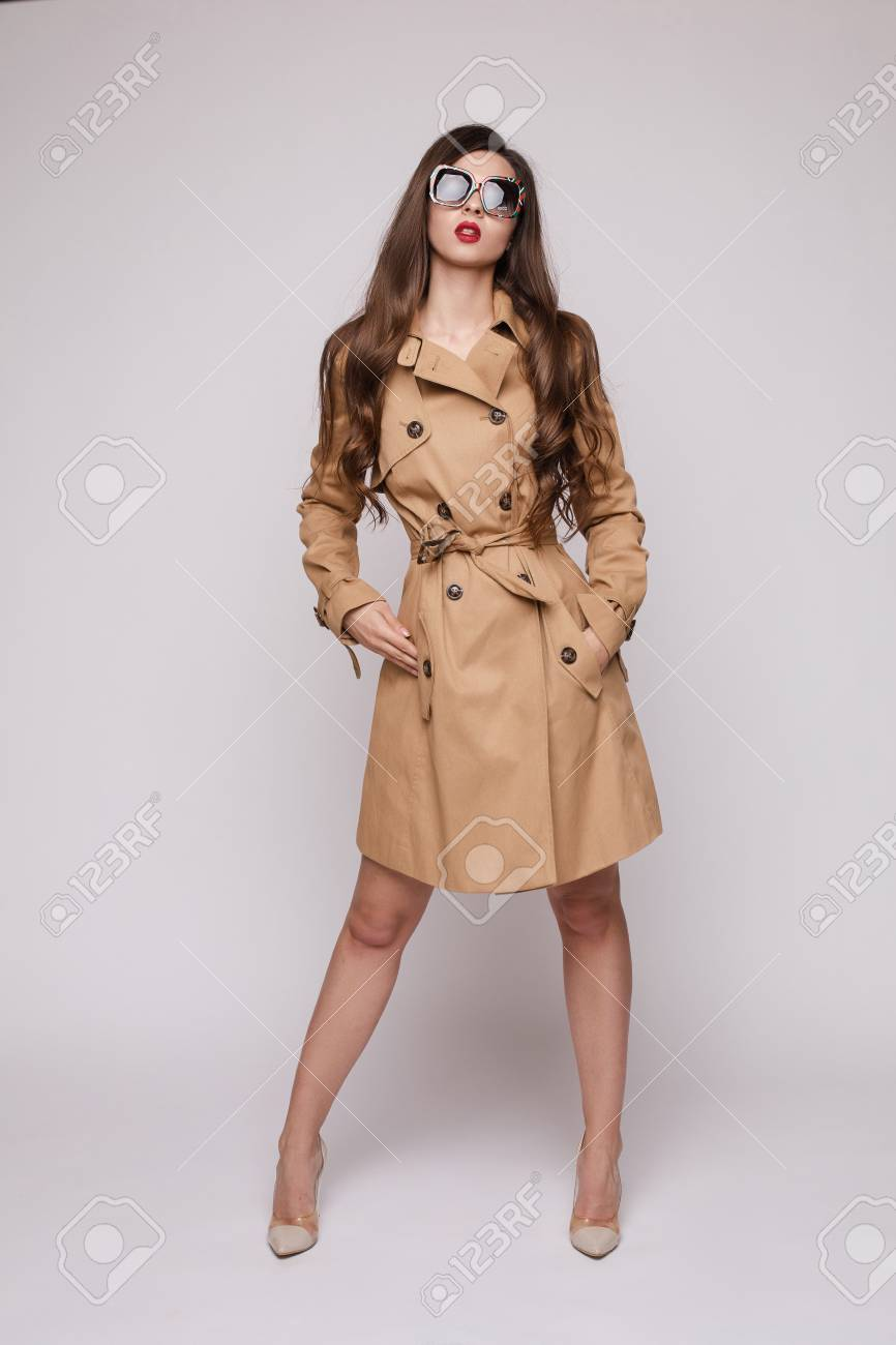 cheap for sale fashion style of 2019 clearance Stunning stylish woman in beige trench coat, sunglasses and high..