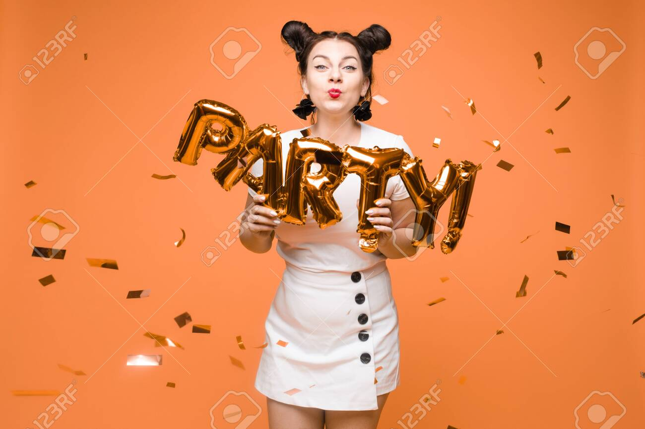 portrait of beautiful woman celebrating a party and having fun - 124402050
