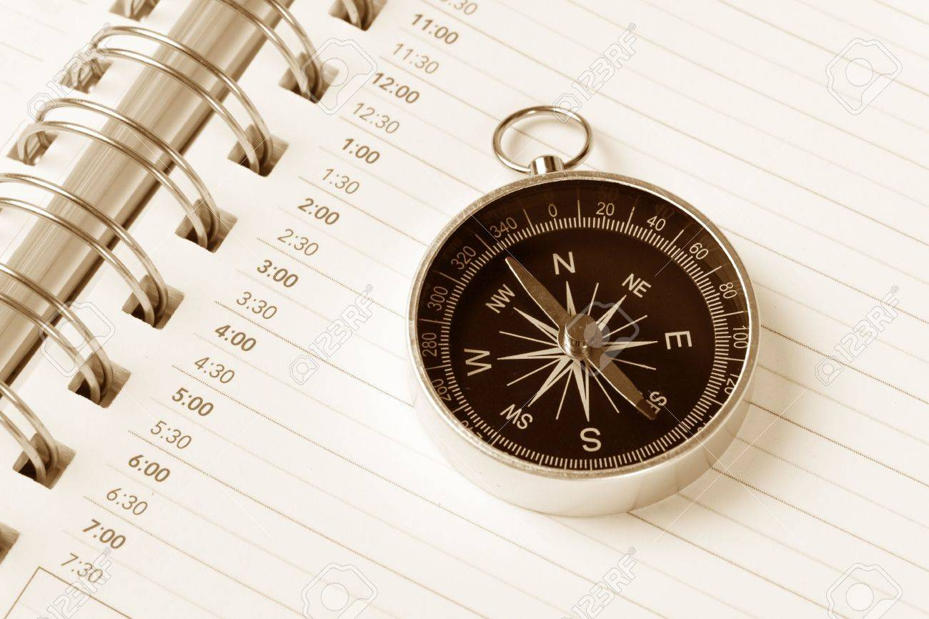 Calendar agenda and compass, concept of time Planning Stock Photo - 3269241