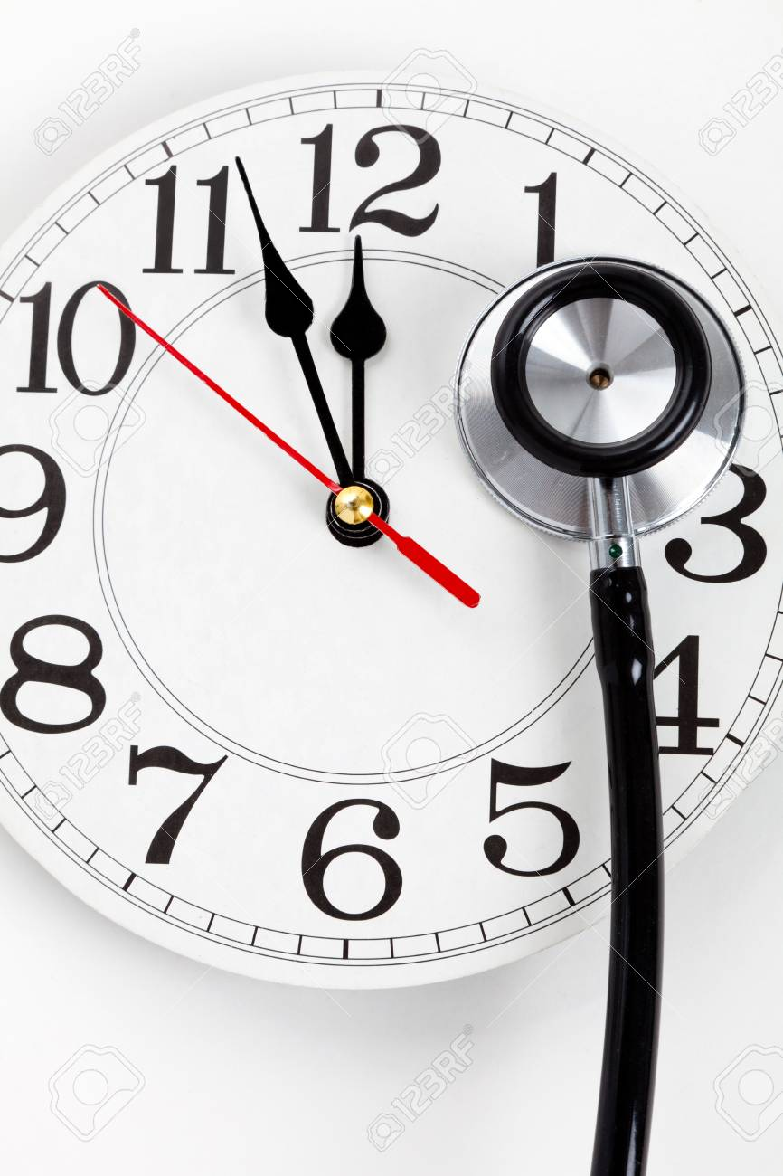 stethoscope and clock concept of time problems stock photo picture